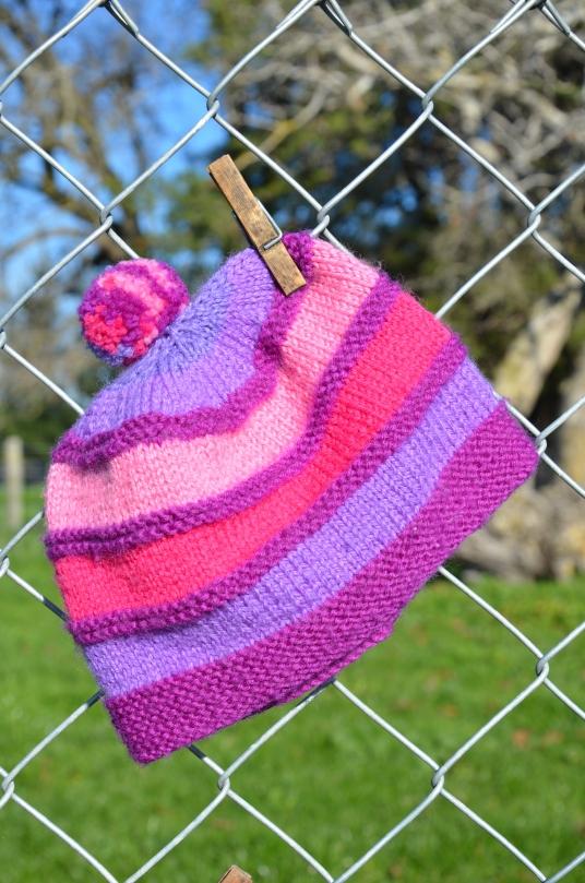 'My Mums lovingly hand knitted pom pom hats.